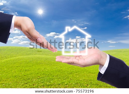 business man hand giving house icon