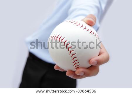 Business man hand holding a baseball - stock photo