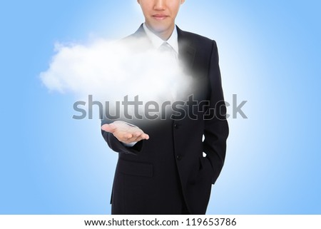 business man hand holding white cloud (great for copy space) with blue sky background, cloud computing concept - stock photo