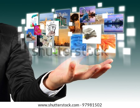 Business man hand holding with  industry image and buildings image flyer - stock photo
