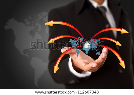 Business man hand holding world map