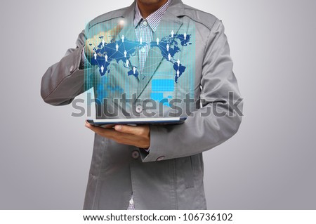 business man hand point to virtual business network process diagram, with on a tablet pc - stock photo