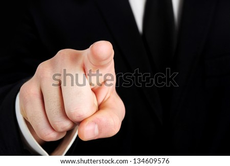 Business man hand pointing camera - stock photo
