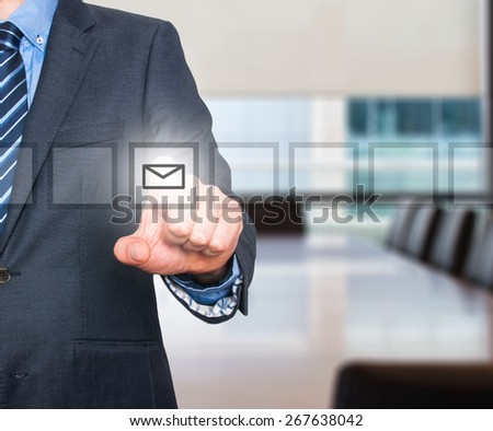 Business man Hand pressing virtual mail button. Communication concept. Isolated on office. Stock Image - stock photo