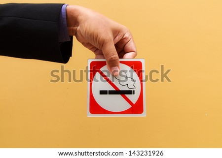 Business man hand show no smoking symbol - stock photo