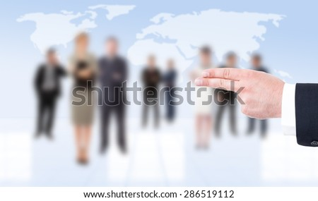 Business man hand showing pistol gesture on business people background - stock photo