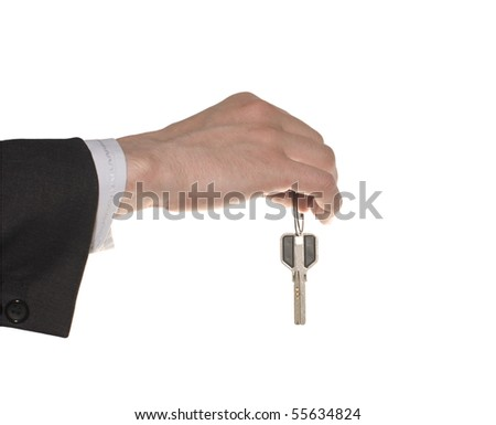business man hand with a key isolated over white