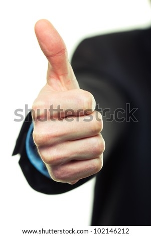 Business man hand with thumb up on white background - stock photo