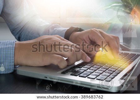 business man hand working with digital business laptop computer on wooden desk as concept - stock photo