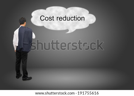 business man hand writing Cost reduction  - stock photo