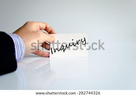 Business man hand writing Inquiry - stock photo