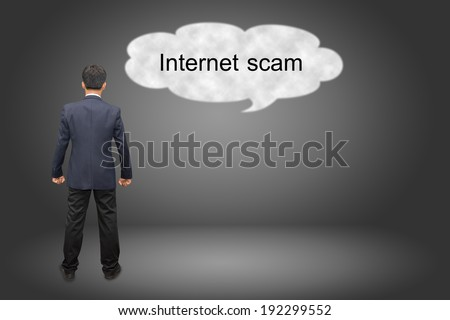 business man hand writing Internet scam - stock photo