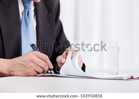 business man hand writing on paper � close up - stock photo