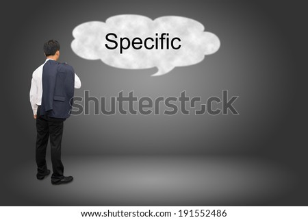 business man hand writing Specific  - stock photo