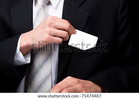 Business man handing a blank business card - stock photo