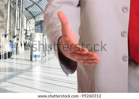 business man handshake at office building - stock photo