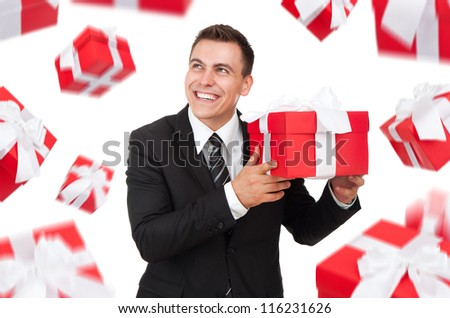 Business man happy smile hold gift box in hands think look up,  present fall fly around. Isolated over white background - stock photo