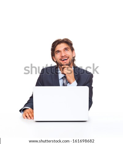 business man happy smile think look up sitting at desk with laptop, handsome young businessman ponder, idea, hold hand finger on chin isolated over white background - stock photo