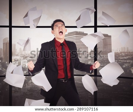 Business man having rage because work overtime - stock photo