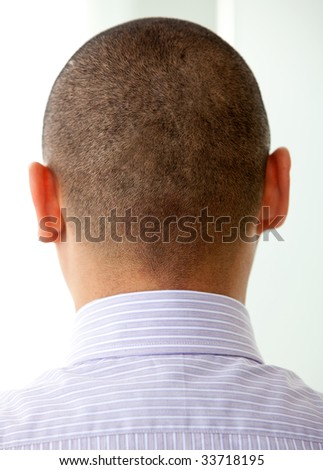 Business man head seen from behind in an office