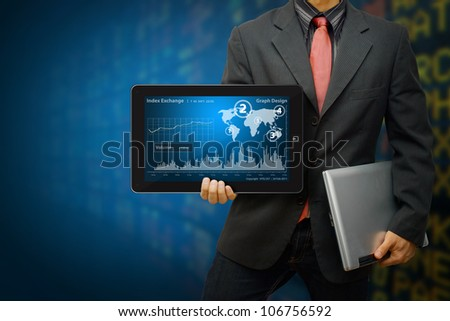 Business man Hold Digital touch pad and present the graph report - stock photo