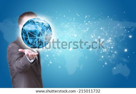 Business man hold Earth in hand. World map as backdrop