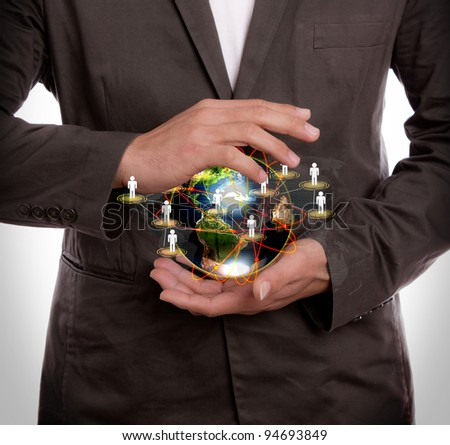 Business man hold earth of social network - stock photo