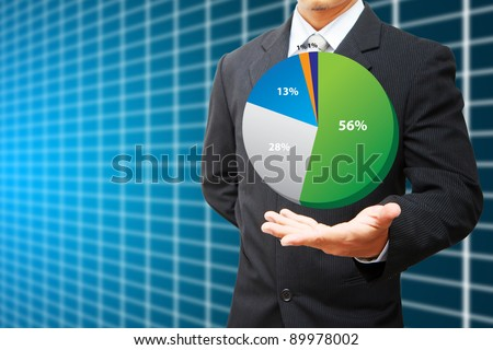 Business man Hold pie chart and table background