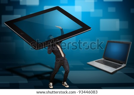 Business man hold the digital tablet computer and notebook computer background