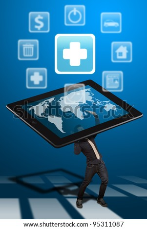 Business man hold the tablet pc and First Aid icon out - stock photo