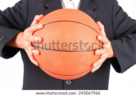 Business man holding a basketball isolated on white background - stock photo