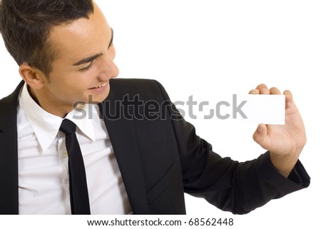 Business man holding a blank business card over white background - stock photo