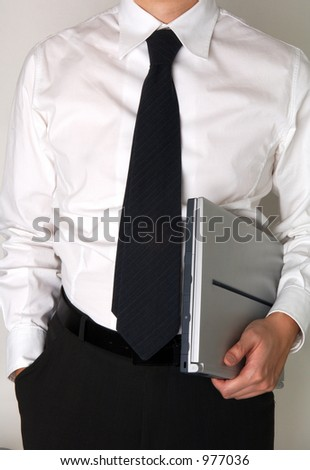 business man holding a laptop - stock photo