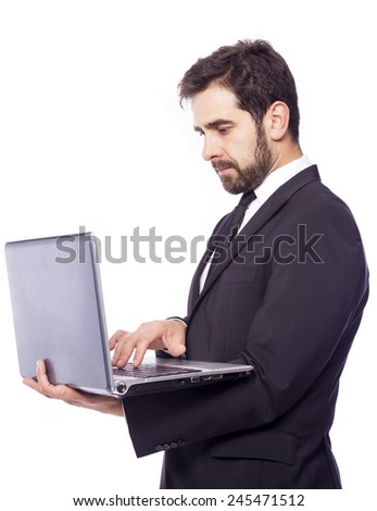 Business man holding a laptop computer, isolated on a white background - stock photo