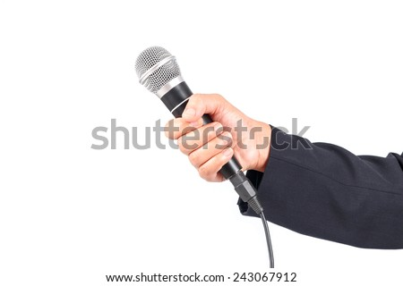 Business man holding a microphone isolated on white background - stock photo