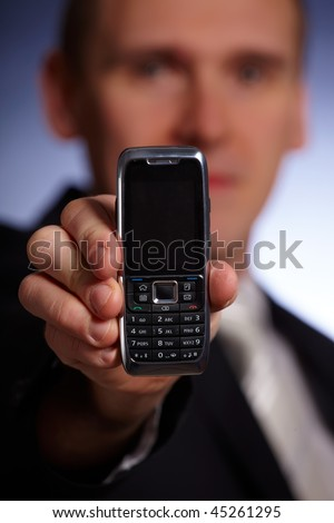 Business man holding a mobile phone, elegant modern design - stock photo