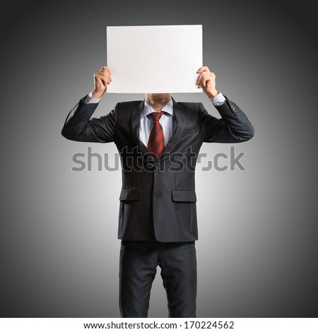 business man holding a poster, place for text - stock photo
