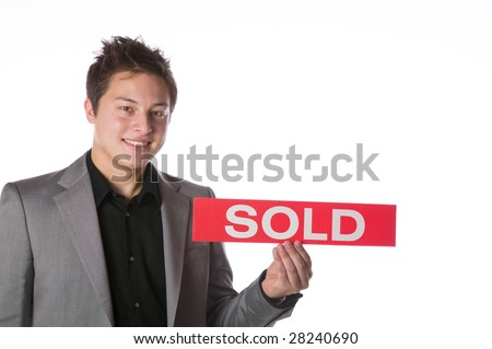 Business man holding a SOLD sign isolated against white background
