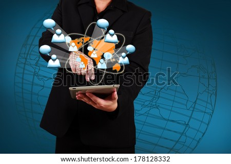 Business man holding a tablet and show social network. - stock photo