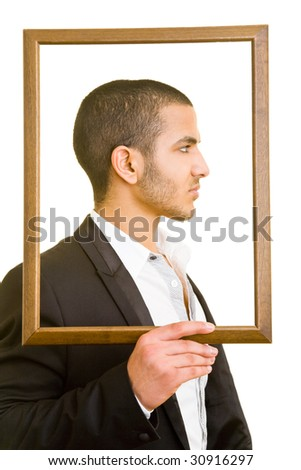Business man holding an empty frame in front of his head - stock photo