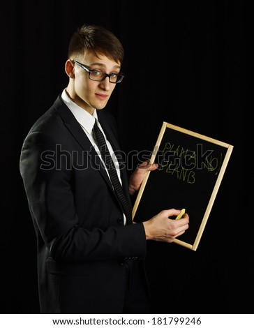 Business man holding blackboard with plan b