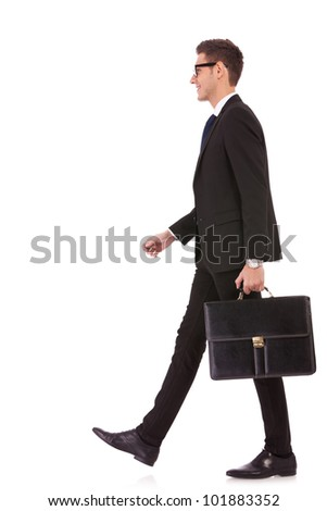 business man holding brief case and walking over white background