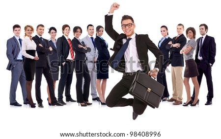 business man holding briefcase jumping with his business team formed of young businessmen and businesswomen standing over a white background with reflections