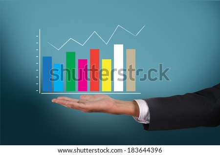Business man holding business growing green graph for success