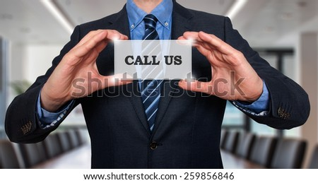Business man holding Call Us card. Office - Stock Photo - stock photo