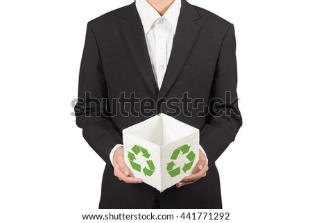business man holding carrying recycling bin - stock photo