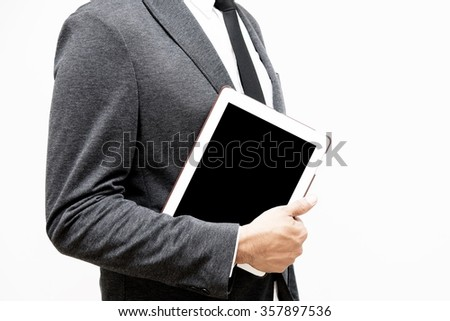 business man holding computer tablet - stock photo