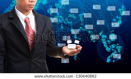 business man holding data and information in hand with blue world map