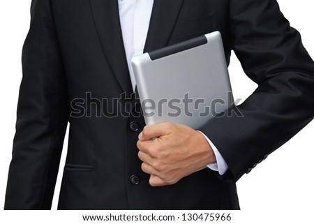 Business man holding digital tablet isolated on white background - stock photo