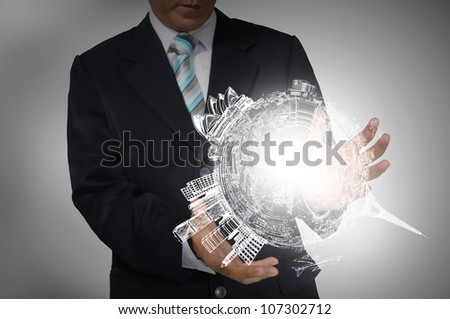 Business Man holding drawing earth globe - stock photo